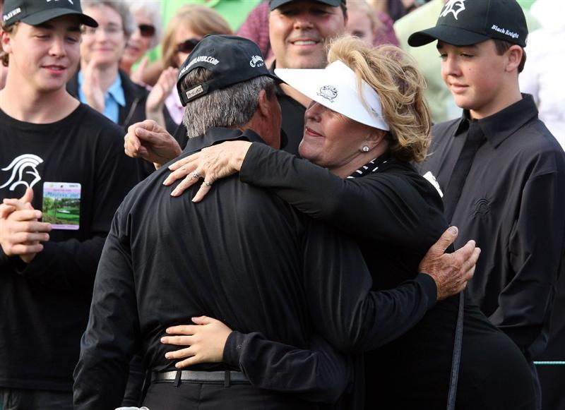 AUGUSTA, GA - APRIL 10:  Gary Player of South Africa hugs his wife Vivienne after his final Masters Tournament at the 2009 Masters Tournament at Augusta National Golf Club on April 10, 2009 in Augusta, Georgia.  (Photo by David Cannon/Getty Images)