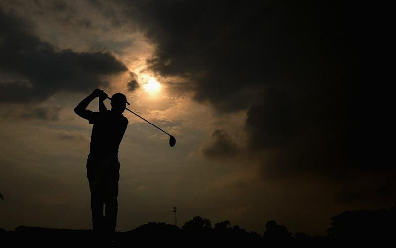 SINGAPORE - NOVEMBER 11:  Niclas Fasth of Sweden in action during the First Round of the Barclays Singapore Open at Sentosa Golf Club on November 11, 2010 in Singapore, Singapore.  (Photo by Ian Walton/Getty Images)