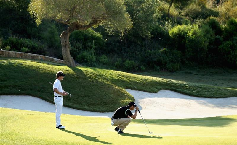 CASARES, SPAIN - MAY 22:  Luke Donald of England and Martin Kaymer of Germany line up their putts on the second green during the semi final of the Volvo World Match Play Championship at Finca Cortesin on May 22, 2011 in Casares, Spain.  (Photo by Warren Little/Getty Images)