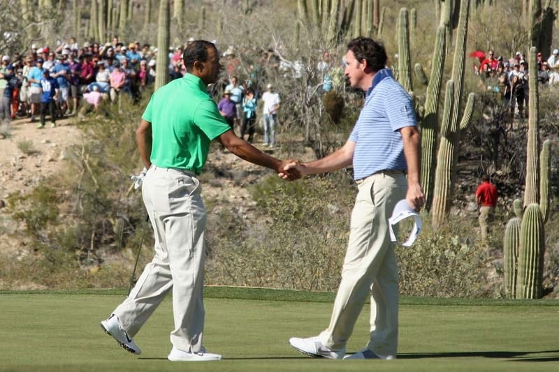 Tiger Woods shakes hands with Gonzalo Fernandez-Castano