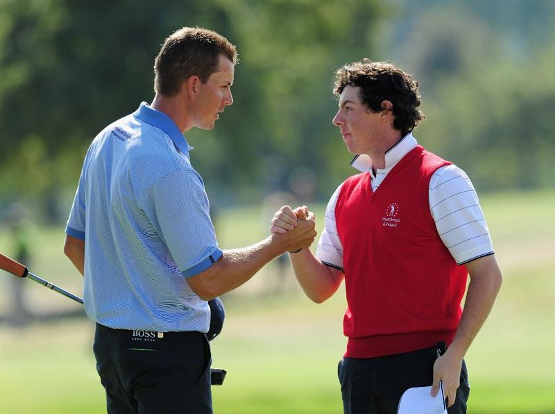 PARIS - SEPTEMBER 27: Henrik Stenson of the Continental Europe congratulates Rory McIlroy of the Great Britain and Northern Ireland team on the 18th hole during the final day singles matches between Great Britain and Northern Ireland and Continental Europe at The Vivendi Trophy with Severiano Ballesteros at Saint - Nom - La Breteche golf course on September 27, 2009 in Paris, France.  (Photo by Stuart Franklin/Getty Images)