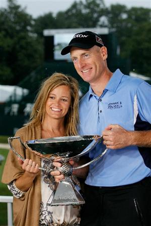 ATLANTA - SEPTEMBER 26:  Jim Furyk (R) and Tabitha Furyk (L) celebrate with the FedExCup Trophy after winning THE TOUR Championship presented by Coca-Cola, the final event of the PGA TOUR Playoffs for the FedExCup, at East Lake Golf Club on September 26, 2010 in Atlanta, Georgia.  (Photo by Kevin C. Cox/Getty Images)