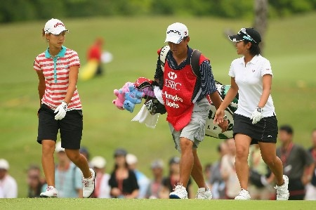 SINGAPORE - MARCH 02:  Momoko Ueda of Japan (left) walks with Ai Miyazato of Japan on the ninth hole during the final round of the HSBC Women's Champions at Tanah Merah Country Club on March 2, 2008 in Singapore.  (Photo by Andrew Redington/Getty Images)