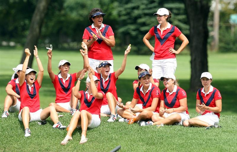 AURORA, IL - AUGUST 19:  Members of the victorious USA team celebrate whilst watching the endof the late matches on the final day of the 2009 Junior Solheim Cup Matches, at the Aurora Country Club on August 19, 2009 in Aurora, Ilinois  (Photo by David Cannon/Getty Images)