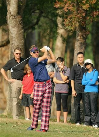 HONG KONG - NOVEMBER 19: Ian Poulter of England watches his 2nd shot on the 13th hole during day two of the UBS Hong Kong Open at The Hong Kong Golf Club on November 19, 2010 in Hong Kong, Hong Kong.  (Photo by Stanley Chou/Getty Images)