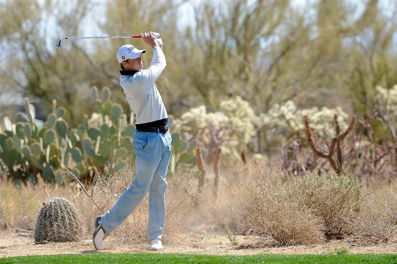 MARANA, AZ - FEBRUARY 24: Nick Watney plays his approach shot on the 11th hole  during the second round of the Accenture Match Play Championship at the Ritz-Carlton Golf Club on February 24, 2011 in Marana, Arizona.  (Photo by Stuart Franklin/Getty Images)