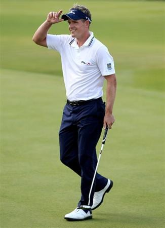 VIRGINIA WATER, ENGLAND - MAY 29:  Luke Donald of England celebrates victory in a playoff on the 18th green during the final round of the BMW PGA Championship  at the Wentworth Club on May 29, 2011 in Virginia Water, England.  (Photo by Richard Heathcote/Getty Images)