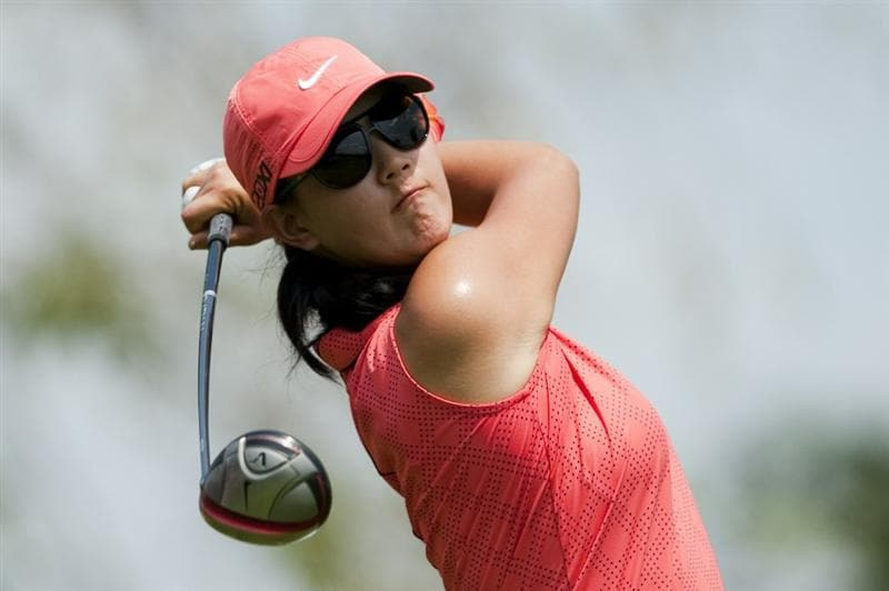 CHON BURI, THAILAND - FEBRUARY 20:  Michelle Wie of USA tees off on the 3rd hole during day four of the LPGA Thailand at Siam Country Club on February 20, 2011 in Chon Buri, Thailand.  (Photo by Victor Fraile/Getty Images)