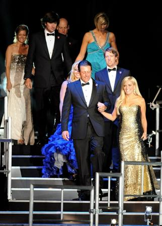CARDIFF, WALES - SEPTEMBER 29:  Phil Mickelson and his wife Amy Mickelson, along with members of the United States Ryder Cup team, walk onstage during Welcome To Wales at Millennium Stadium on September 29, 2010 in Cardiff, Wales.  (Photo by Eamonn McCormack/Getty Images)