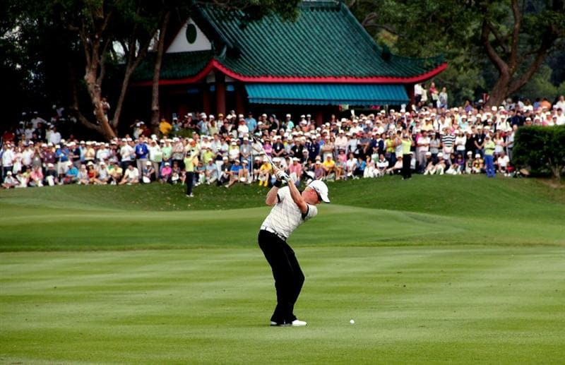 HONG KONG - NOVEMBER 21:  Simon Dyson of England hits a shot from the fairway during day four of the UBS Hong Kong Open at The Hong Kong Golf Club on November 21, 2010 in Hong Kong.  (Photo by Stanley Chou/Getty Images)