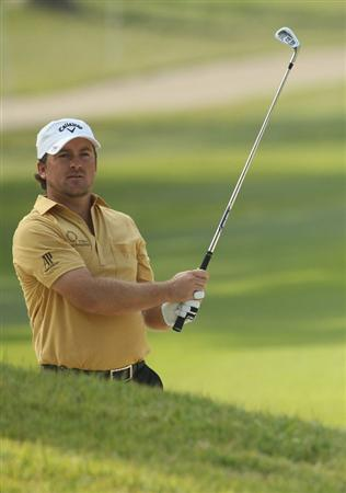 HONG KONG - NOVEMBER 18:  Graeme McDowell of Northern Ireland looks on after playing a shot during day one of the UBS Hong Kong Open at The Hong Kong Golf Club on November 18, 2010 in Hong Kong, Hong Kong.  (Photo by Ian Walton/Getty Images)