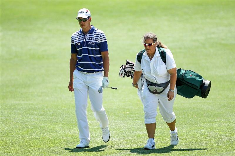 AUGUSTA, GA - APRIL 04:  Henrik Stenson of Sweden walks with his caddie Fanny Sunesson during a practice round prior to the 2011 Masters Tournament at Augusta National Golf Club on April 4, 2011 in Augusta, Georgia.  (Photo by Andrew Redington/Getty Images)