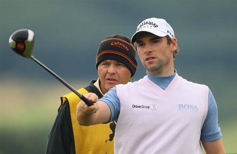 PERTH, UNITED KINGDOM - AUGUST 28:  Oliver Wilson of England takes some advice from his caddie as prepares to hit his tee-shot on the 12th hole during the first round of The Johnnie Walker Championship at Gleneagles on August 28, 2008 at the Gleneagles Hotel and Resort in Perthshire, Scotland.  (Photo by Andrew Redington/Getty Images)