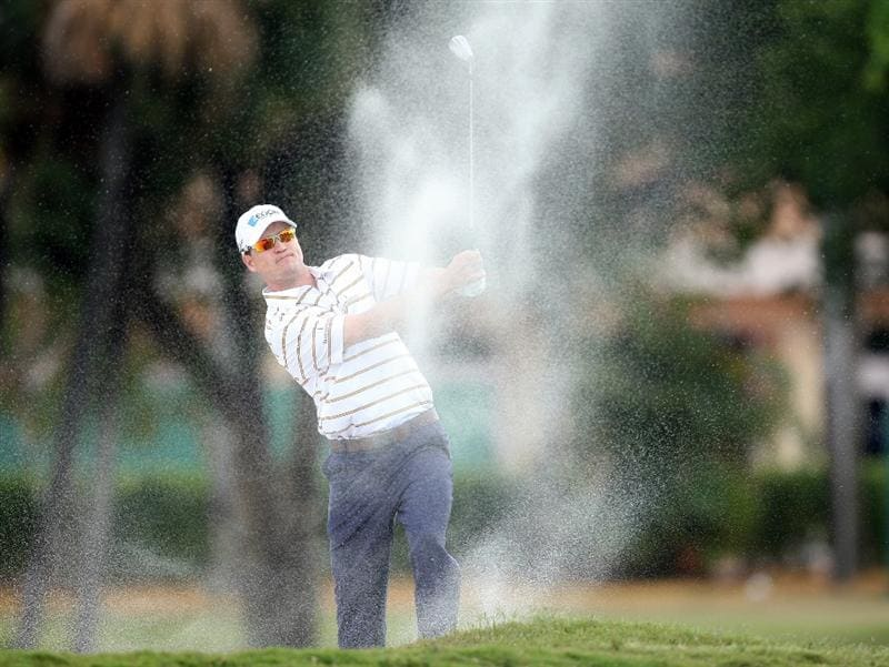 DORAL, FL - MARCH 13:  Zach Johnson of the USA plays his second shot at the 1st hole during the second round of the World Golf Championships-CA Championship at the Doral Golf Resort & Spa on March 13, 2009 in Miami, Florida  (Photo by David Cannon/Getty Images)