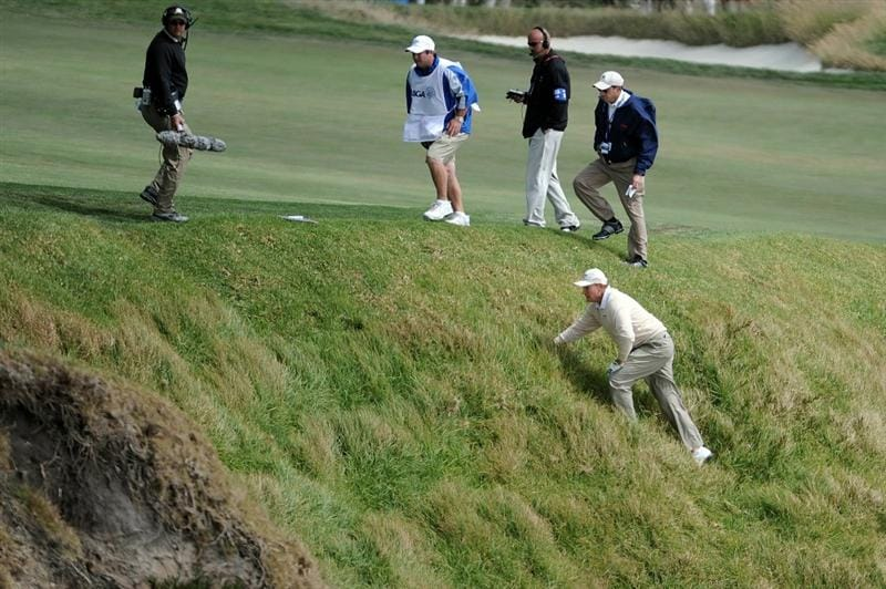 PEBBLE BEACH, CA - JUNE 20:  Ernie Els of South Africa climbs on the cliff after his errant tee shot on the ninth hole during the final round of the 110th U.S. Open at Pebble Beach Golf Links on June 20, 2010 in Pebble Beach, California.  (Photo by Harry How/Getty Images)