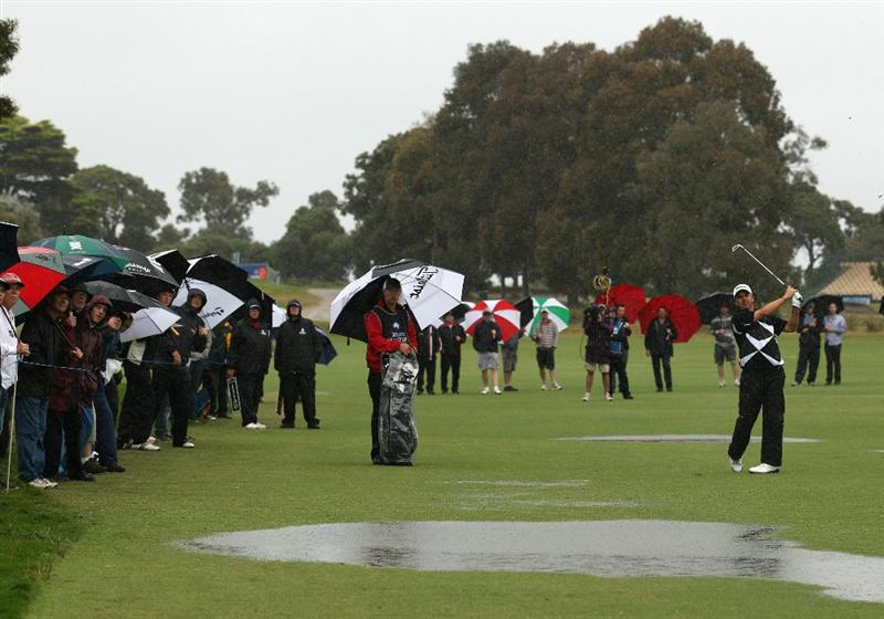 MELBOURNE, AUSTRALIA - NOVEMBER 13:  Andre Stolz of Australia hits down a flooded fairway during round three of the Australian Masters at The Victoria Golf Club on November 13, 2010 in Melbourne, Australia.  (Photo by Ryan Pierse/Getty Images)