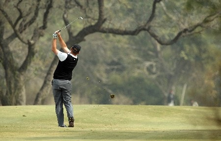 DELHI, INDIA - FEBRUARY 7:  Thomas Bjorn of Denmark plays his second shot at the 4th hole during the first round of the Emaar-MGF Indian Masters at the Delhi Golf Club on February 7, 2008 in Delhi, India.  (Photo by David Cannon/Getty Images)