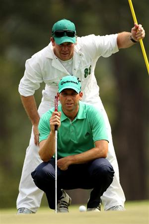 AUGUSTA, GA - APRIL 09:  Sergio Garcia of Spain lines up a putt with the help of caddie Gary Matthews  on the eighth hole green during the third round of the 2011 Masters Tournament at Augusta National Golf Club on April 9, 2011 in Augusta, Georgia.  (Photo by Andrew Redington/Getty Images)