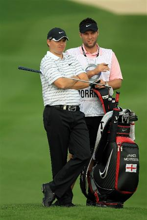 BAHRAIN, BAHRAIN - JANUARY 27:  James Morrison of England plays his third shot at the 14th hole during the first round of the 2011 Volvo Champions held at the Royal Golf Club on January 27, 2011 in Bahrain, Bahrain.  (Photo by David Cannon/Getty Images)