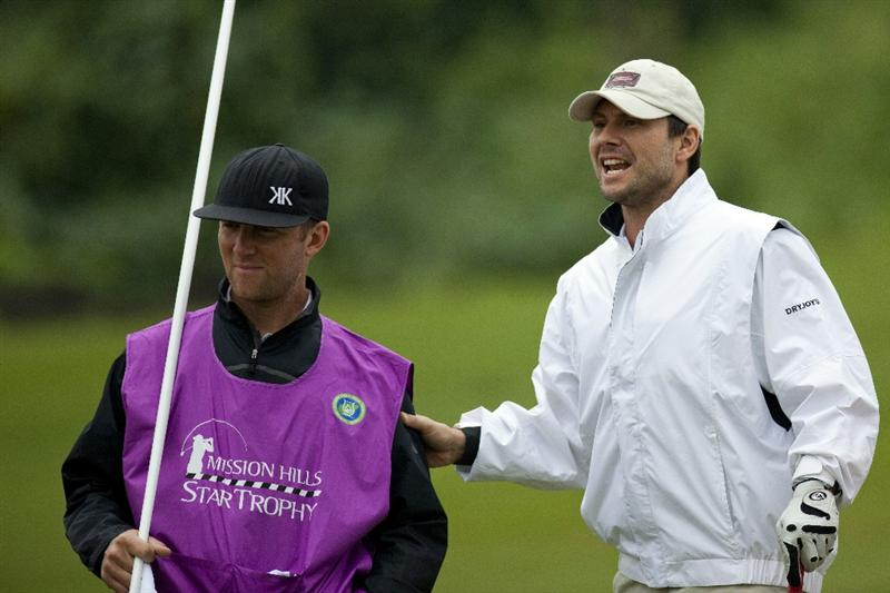 HAIKOU, CHINA - OCTOBER 28:  Actor Christian Slater (R) speaks to his caddie during the Mission Hills Star Trophy at Blackstone Course, Mission Hill Hainan on October 28, 2010 in Haikou, China. The Mission Hills Star Trophy is Asia's leading leisure lifestyle event which features Hollywood celebrities and international golf stars.  (Photo by Athit Perawongmetha/Getty Images)