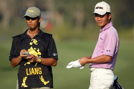 NEW DELHI, INDIA - FEBRUARY 29:  Wen-chong Liang of China prepares to hit his second shot at the 18th hole during the second round of the 2008 Johnnie Walker Classic held at The DLF Golf and Country Club on February 29, 2008 in New Delhi, India.  (Photo by David Cannon/Getty Images)