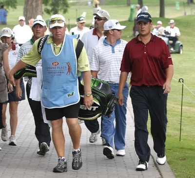 Jeff Quinney (r) heads for the Clubhouse after a thunderstorm moved into the area and suspended play at 11:23 CST during the first round of the Crowne Plaza Invitational at Colonial at the Colonial Country Club in Fort Worth, Texas on May 24, 2007. PGA TOUR - 2007 Crowne Plaza Invitational at Colonial - First RoundPhoto by Steve Grayson/WireImage.com