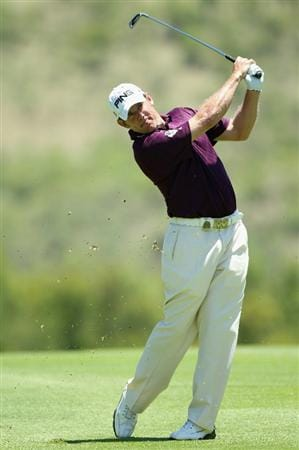 SUN CITY, SOUTH AFRICA - DECEMBER 04:  Lee Westwood of England plays his second shot on the second hole during the third round of the 2010 Nedbank Golf Challenge at the Gary Player Country Club Course  on December 4, 2010 in Sun City, South Africa.  (Photo by Warren Little/Getty Images)