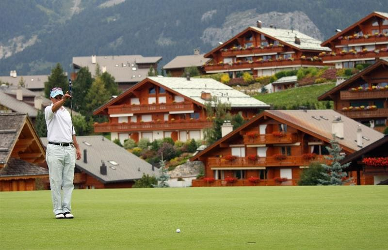 CRANS, SWITZERLAND - SEPTEMBER 06:  Juan Abbate of Argentina lines up a putt on the 14th hole during the third round of the Omega European Masters at Crans-Sur-Sierre Golf Club on September 6, 2008 in Crans Montana, Switzerland.  (Photo by Andrew Redington/Getty Images)