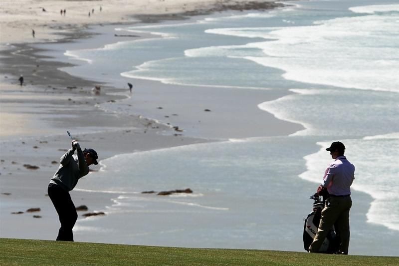 PEBBLE BEACH, CA - JUNE 16:  Tom Watson hits a shot as his son/caddie Michael looks on during a practice round prior to the start of the 110th U.S. Open at Pebble Beach Golf Links on June 16, 2010 in Pebble Beach, California.  (Photo by Ross Kinnaird/Getty Images)