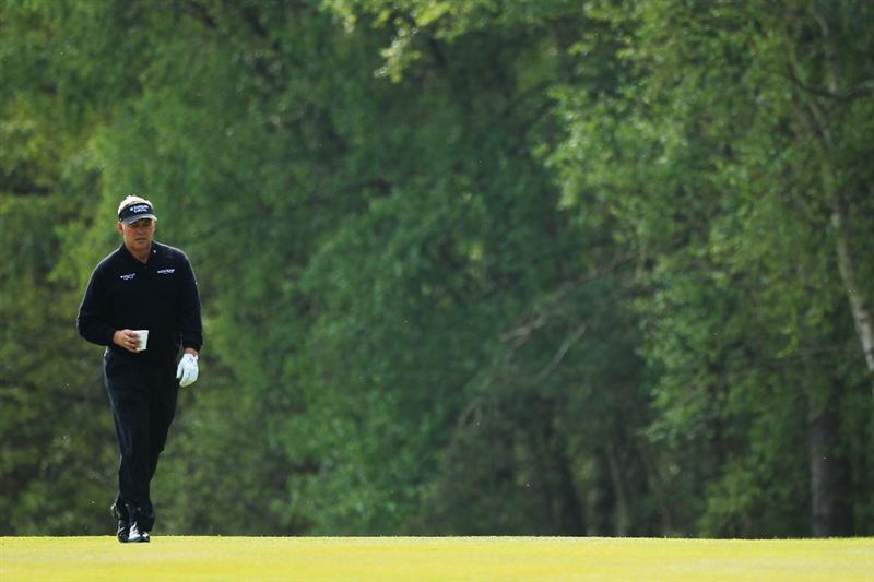 VIRGINIA WATER, ENGLAND - MAY 19:  Darren Clarke of Northern Ireland walks up the 9th fairway during the Pro-Am round prior to the BMW PGA Championship on the West Course at Wentworth on May 19, 2010 in Virginia Water, England.  (Photo by Warren Little/Getty Images)