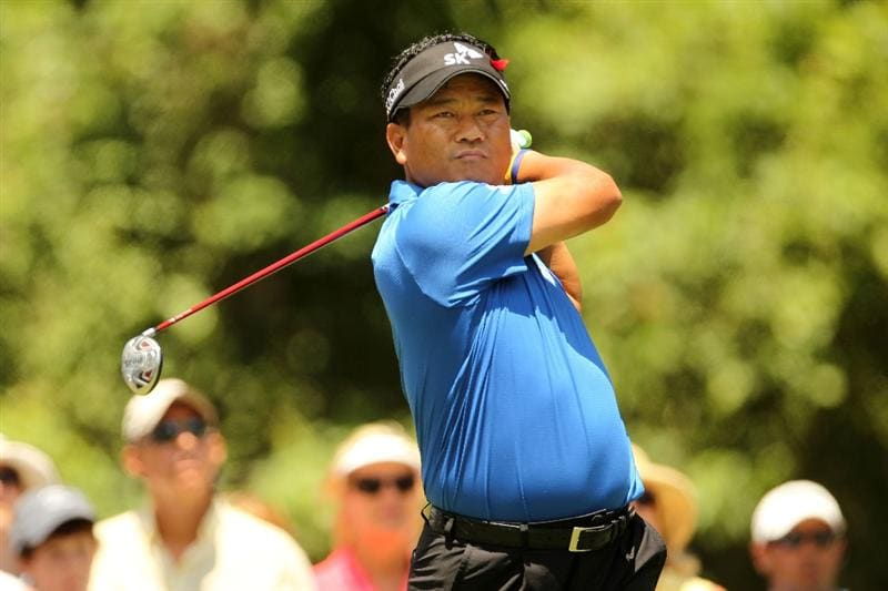 PONTE VEDRA BEACH, FL - MAY 15:  K.J. Choi of South Korea hits his tee shot on the second hole during the final round of THE PLAYERS Championship held at THE PLAYERS Stadium course at TPC Sawgrass on May 15, 2011 in Ponte Vedra Beach, Florida.  (Photo by Mike Ehrmann/Getty Images)