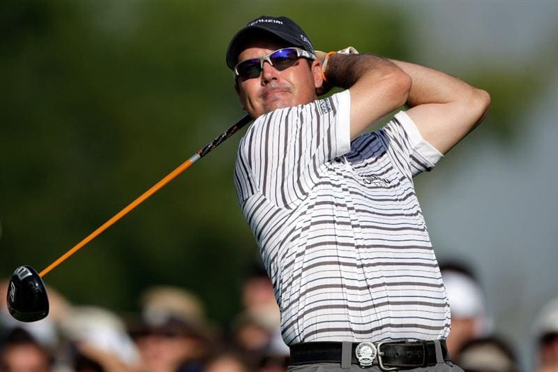 CHASKA, MN - AUGUST 13:  Rich Beem watches his tee shot on the 11th hole during the first round of the 91st PGA Championship at Hazeltine National Golf Club on August 13, 2009 in Chaska, Minnesota.  (Photo by Jamie Squire/Getty Images)