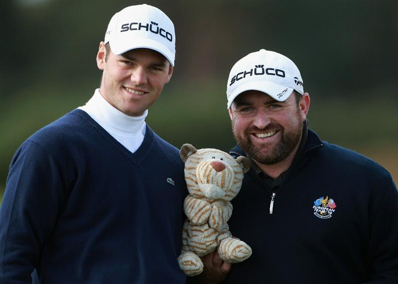 CARNOUSTIE, SCOTLAND - OCTOBER 06:  Martin Kaymer of Germany (left) and his caddie Craig Connelly pose with his driver headcover during a practice round for The Alfred Dunhill Links Championship at Carnoustie Golf Links on October 6, 2010 in Carnoustie, Scotland.  (Photo by Andrew Redington/Getty Images)