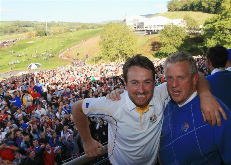 NEWPORT, WALES - OCTOBER 04:  European Team captain Colin Montgomerie (R) of Europe poses with Graeme McDowell on the balcony of the clubhouse following Europe's victory during the 2010 Ryder Cup at the Celtic Manor Resort on October 4, 2010 in Newport, Wales.  (Photo by David Cannon/Getty Images)