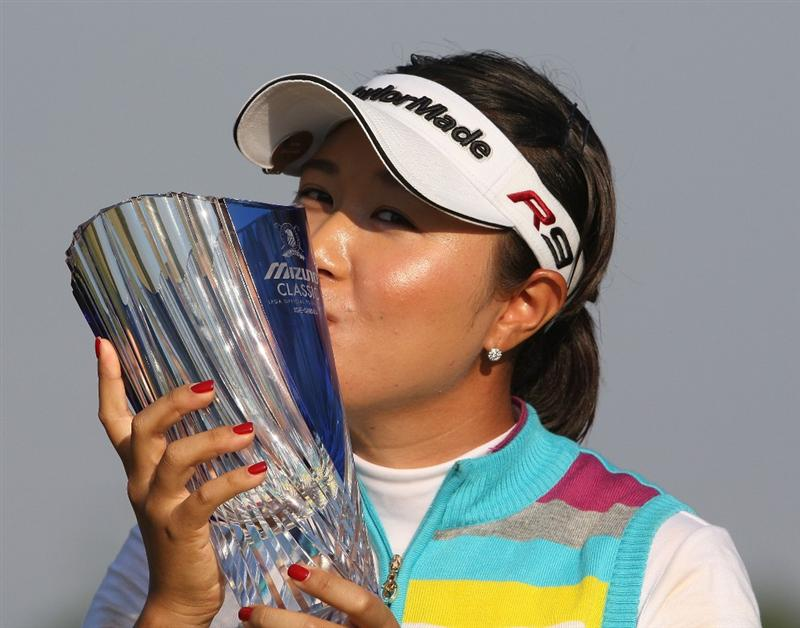 SHIMA, JAPAN - NOVEMBER 08:  Bo Bae Song of South Korea kisses the trophy after winning the Mizuno Classic at Mizuno Classicat Kintetsu Kashikojima Country Club on November 8, 2009 in Shima, Japan.  (Photo by Koichi Kamoshida/Getty Images)