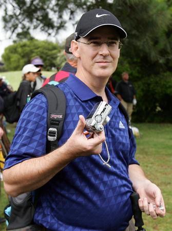 SYDNEY, AUSTRALIA - DECEMBER 11:  Spectator Brad Clegg displays his camera that was thrown against a tree by John Daly of the USA on the ninth hole during the first round of the 2008 Australian Open at The Royal Sydney Golf Club on December 11, 2008 in Sydney, Australia.  (Photo by Mark Nolan/Getty Images)