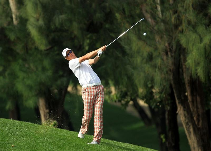 DUBAI, UNITED ARAB EMIRATES - FEBRUARY 11:  Fredrik Andersson Hed of Sweden plays his second shot at the 1st hole during the second round of the 2011 Omega Dubai Desert Classic on the Majilis Course at the Emirates Golf Club on February 11, 2011 in Dubai, United Arab Emirates.  (Photo by David Cannon/Getty Images)