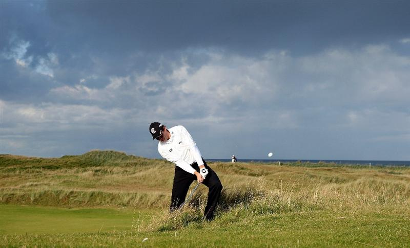 KINGSBARNS, UNITED KINGDOM - OCTOBER 02:  David Howell of England plays out from the rough on the seventh hole during the first round of The Alfred Dunhill Links Championship at Kingsbarns Golf Links on October 2, 2008 in Kingbarns, Scotland.  (Photo by David Cannon/Getty Images)