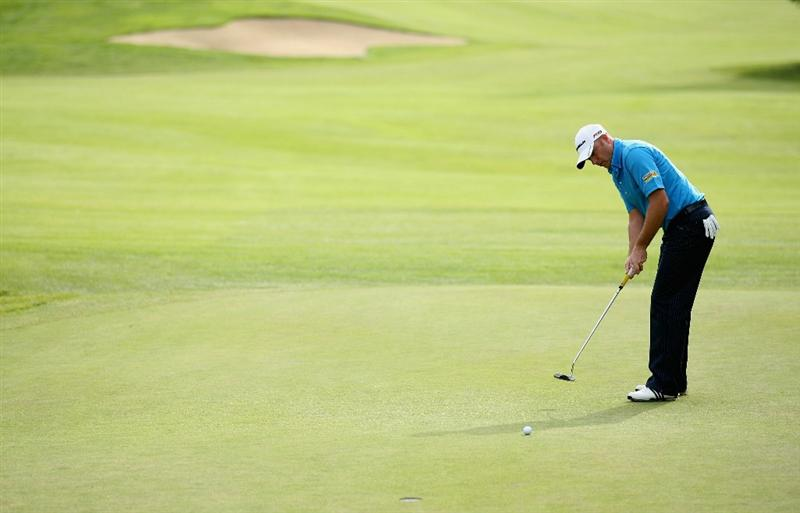 CRANS, SWITZERLAND - SEPTEMBER 02:  Graeme Storm of England putts for birdie on the ninth green during the first round of The Omega European Masters at Crans-Sur-Sierre Golf Club on September 2, 2010 in Crans Montana, Switzerland.  (Photo by Warren Little/Getty Images)