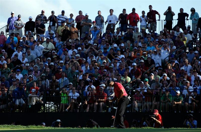 CHASKA, MN - AUGUST 16:  Tiger Woods reacts to a missed par putt on the 17th hole during the final round of the 91st PGA Championship at Hazeltine National Golf Club on August 16, 2009 in Chaska, Minnesota.  (Photo by Jamie Squire/Getty Images)
