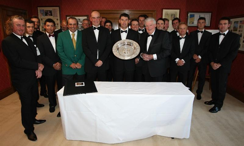 WENTWORTH, ENGLAND - MAY 20:  Padraig Harrington of Ireland (C) is presented with the Players' Player Award by Thomas Bjorn of Denmark (his left) and John Jacobs (his right) of England and a group pf European Tour players during The Tour Dinner at  the BMW PGA Championship at Wentworth on May 19, 2009 in Virginia Water, England.  (Photo by Andrew Redington/Getty Images)