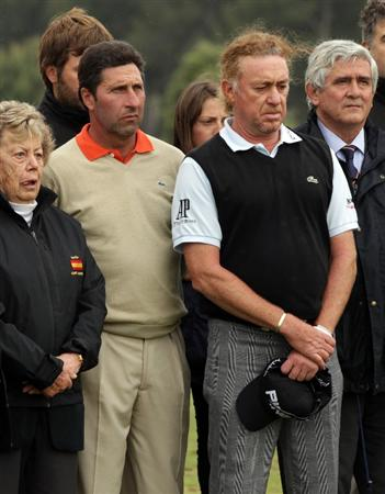 BARCELONA, SPAIN - MAY 07: Jose Maria Olazabal of Spain and Miguel Angel Jimenez of Spain during the minute silence held in memory of Seve Ballesteros  during the third round of the Open de Espana at the the Real Club de Golf El Prat on May 7 , 2011 in Barcelona, Spain.  (Photo by Ross Kinnaird/Getty Images)