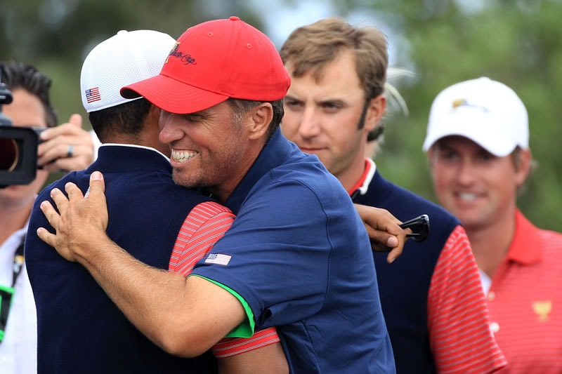 Tiger Woods and Jim Mackay