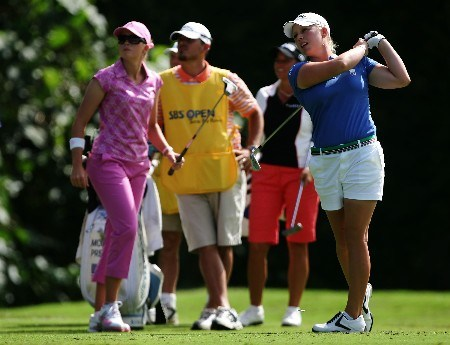 KAHUKU, HI - FEBRUARY 17:  Morgan Pressel hits a tee shot on the 13th hole as Paula Creamer and Sherri Steinhauer look on during the final round of the SBS Open, the first event of the 2007 LPGA season at the Turtle Bay Resort Arnold Palmer Course February 17, 2007 in Kahuku, Hawaii.  (Photo by Harry How/Getty Images)