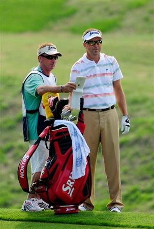 PONTE VEDRA BEACH, FL - MAY 06:  Robert Allenby of Australia (R) chats with his caddie on the seventh hole during the first round of THE PLAYERS Championship held at THE PLAYERS Stadium course at TPC Sawgrass on May 6, 2010 in Ponte Vedra Beach, Florida.  (Photo by Sam Greenwood/Getty Images)
