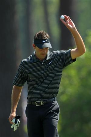 AUGUSTA, GA - APRIL 10:  Charl Schwartzel of South Africa waves to the gallery after holing a shot for eagle on the third green during the final round of the 2011 Masters Tournament on April 10, 2011 in Augusta, Georgia.  (Photo by Jamie Squire/Getty Images)