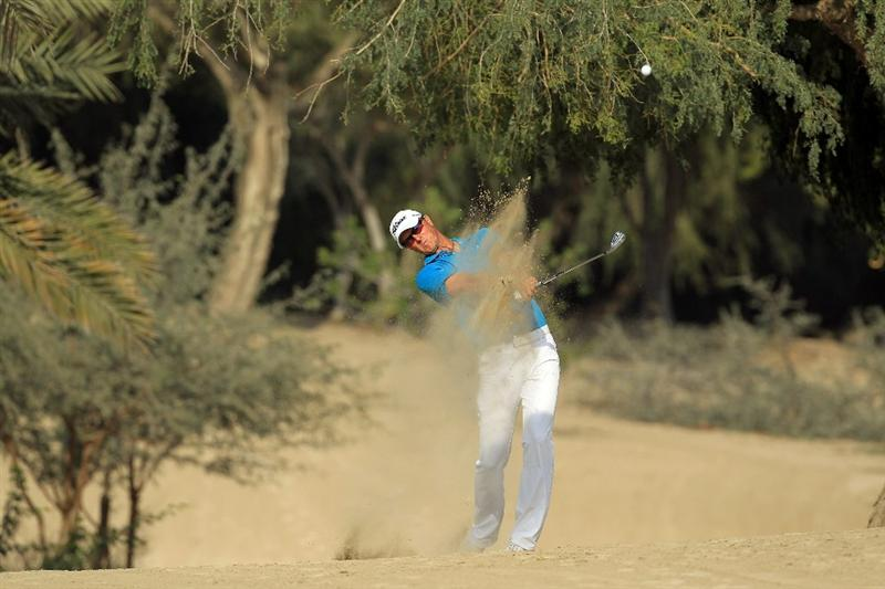 DUBAI, UNITED ARAB EMIRATES - FEBRUARY 10:  Fredrik Andersson Hed of Sweden plays his second shot to the 14th hole during the first round of the 2011 Omega Dubai Desert Classic on the Majilis Course at the Emirates Golf Club on February 10, 2011 in Dubai, United Arab Emirates.  (Photo by David Cannon/Getty Images)