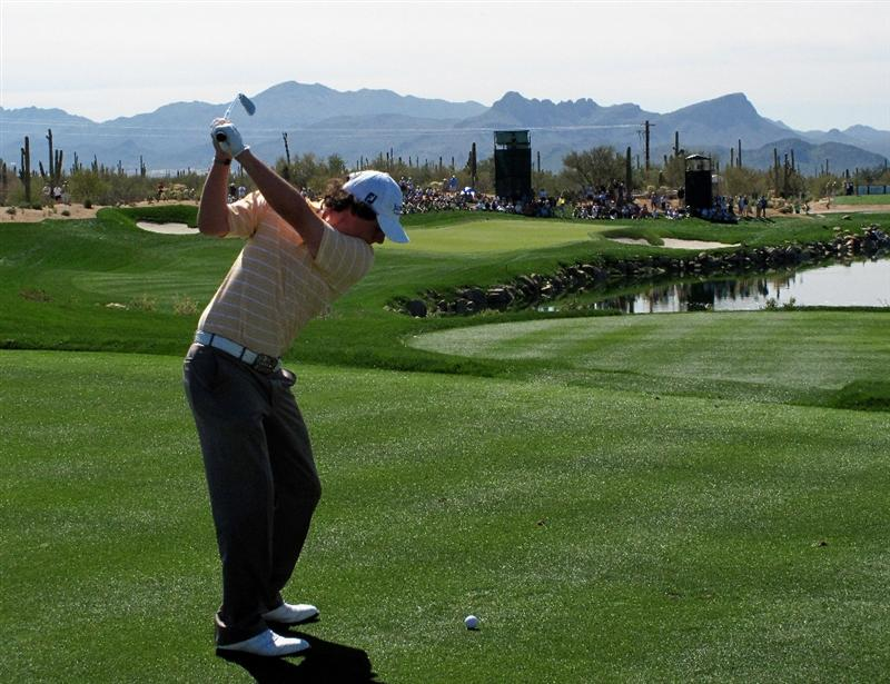 MARANA, AZ - FEBRUARY 27:  Rory McIlroy of Northern Ireland plays his tee shot on the third hole during the third round of Accenture Match Play Championships at Ritz - Carlton Golf Club at Dove Mountain on February 27, 2009 in Marana, Arizona.  (Photo by Stuart Franklin/Getty Images)