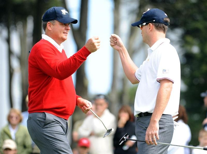 SAN FRANCISCO - OCTOBER 08:  Kenny Perry and Zach Johnson of the USA Team celebrate winning the 6th hole during the Day One Foursome Matches of The Presidents Cup at Harding Park Golf Course on October 8, 2009 in San Francisco, California.  (Photo by Harry How/Getty Images)
