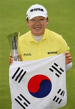 SUNNINGDALE, UNITED KINGDOM - AUGUST 03:  Ji-Yai Shin of South Korea poses with the trophy and the flag of South Korea after winning the 2008 Ricoh Women's British Open held on the Old Course at Sunningdale Golf Club on Ausgust 3, 2008 in Sunningdale, England.  (Photo by Warren Little/Getty Images)